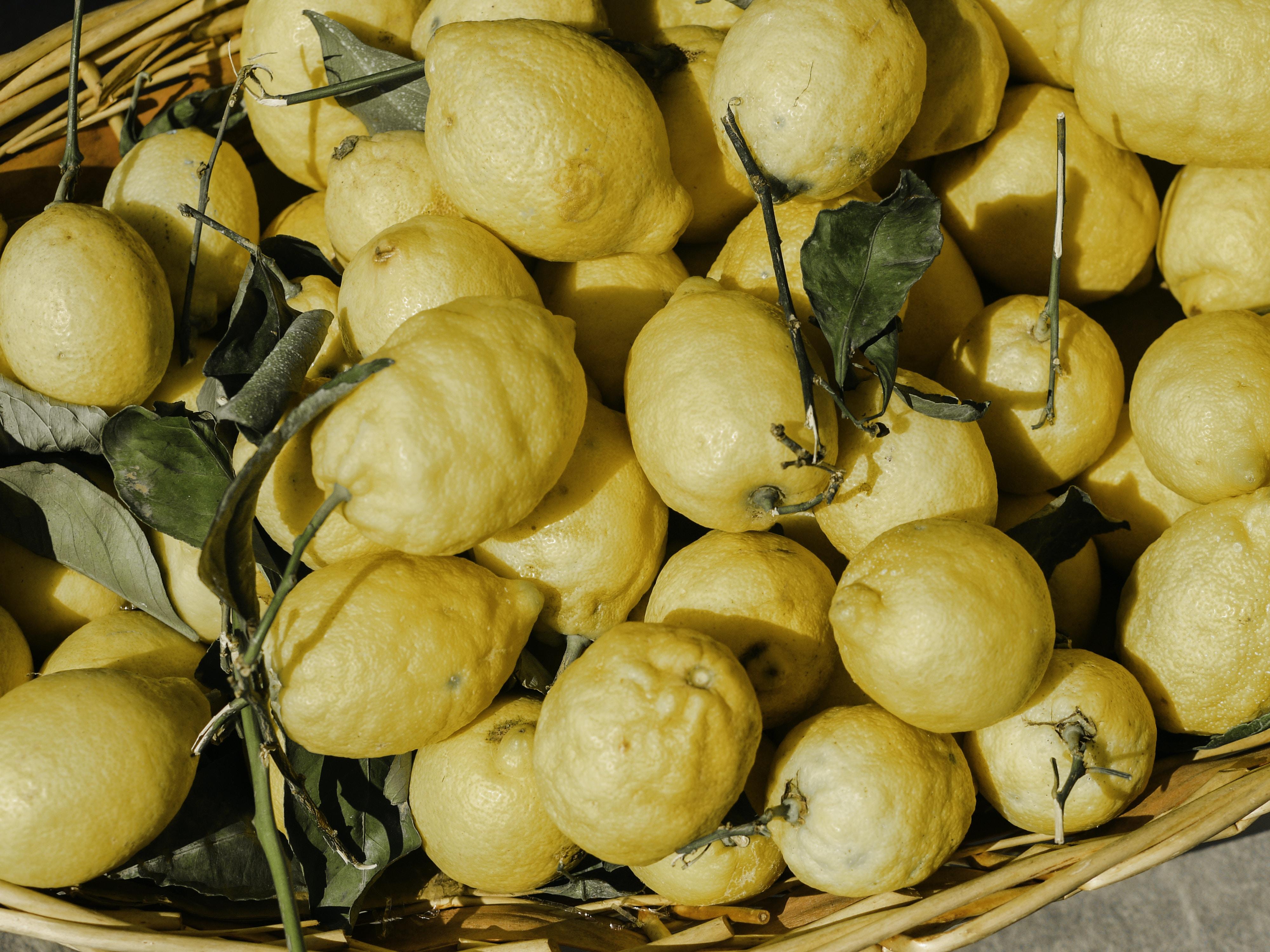 yellow fruits on brown basket
