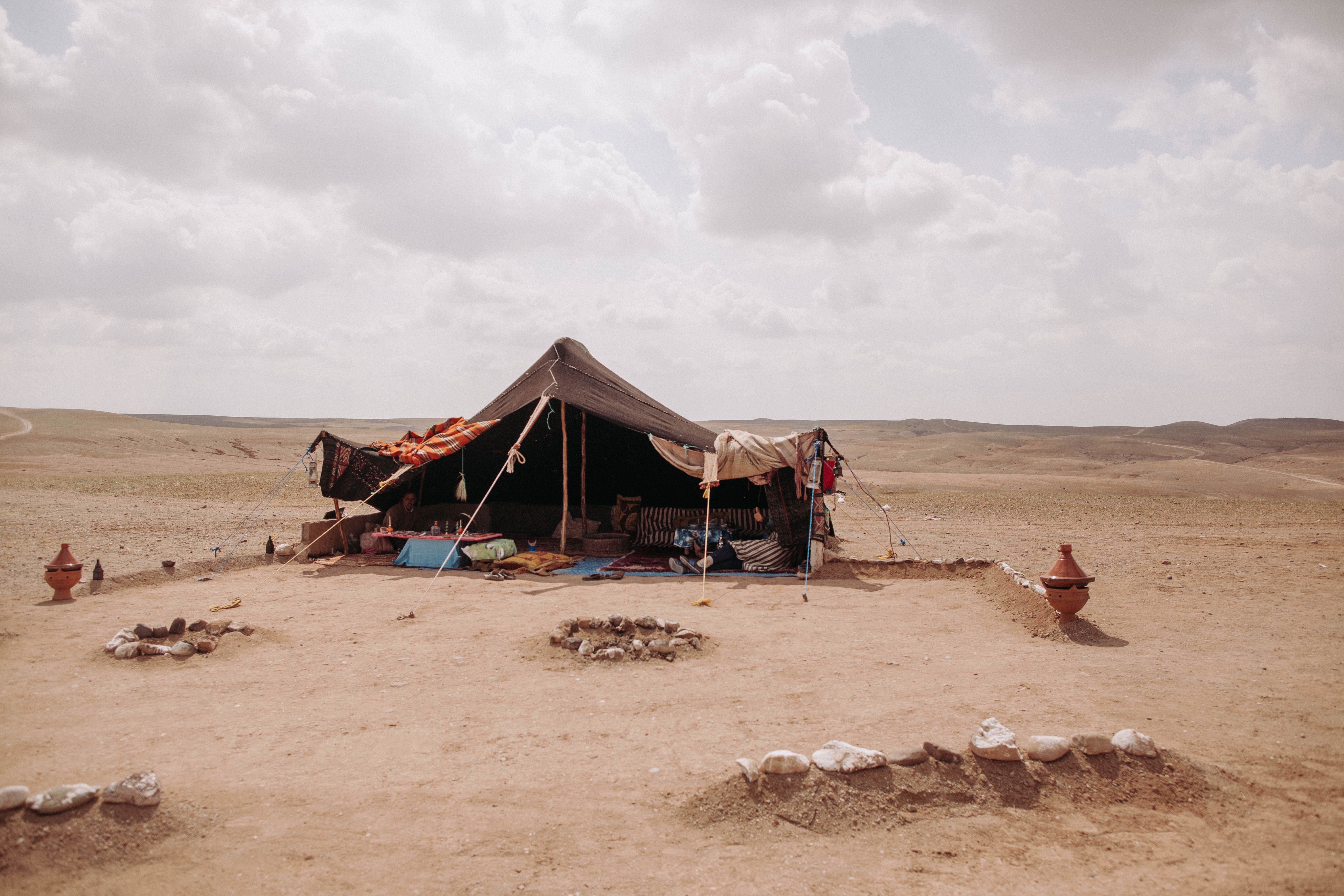 brown dome tent on desert