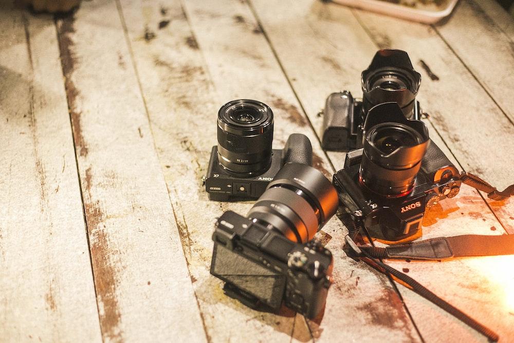 four DSLR cameras on floor