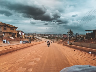 person riding on motorcycle nigeria teams background