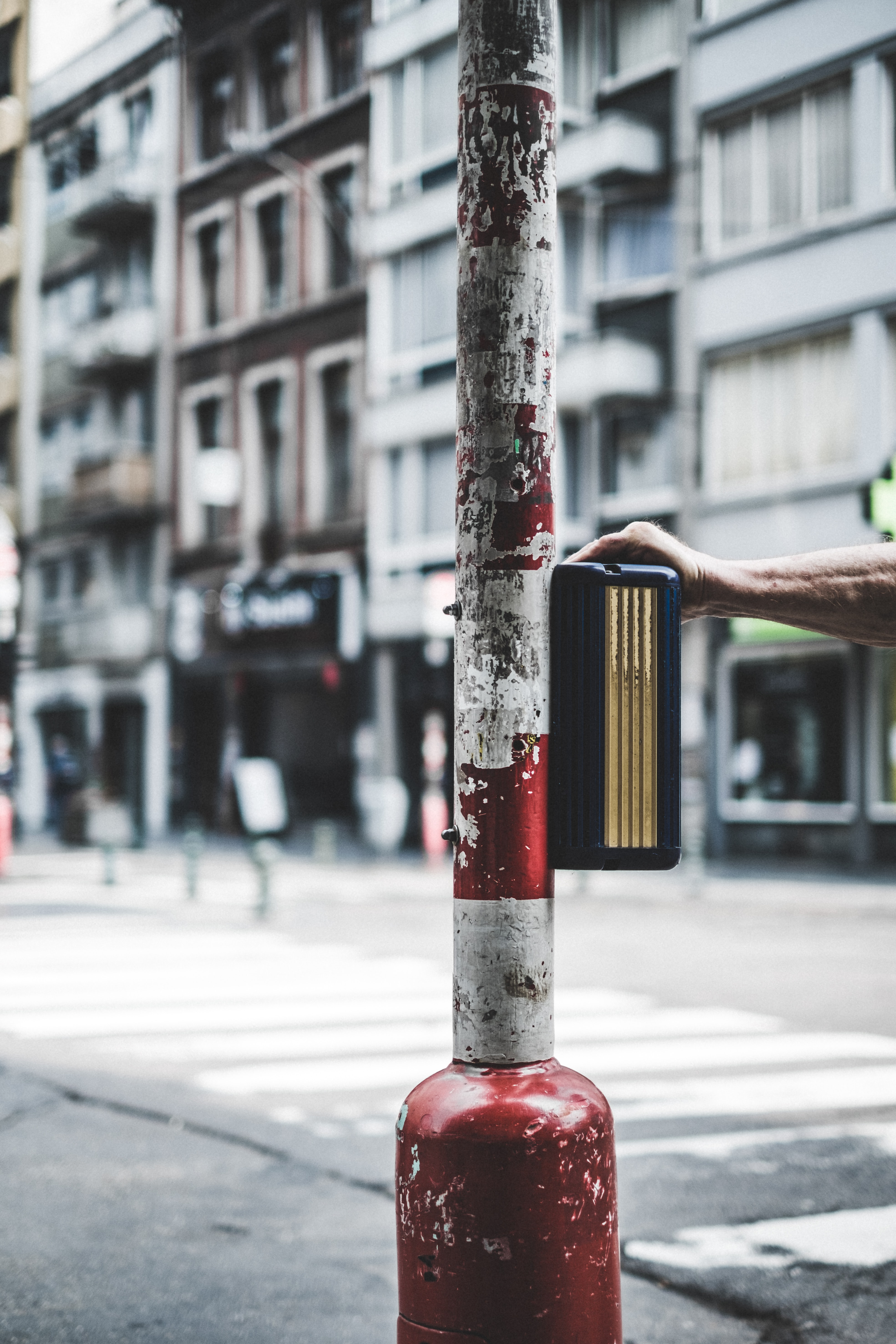 selective focus photography of white and red striped street pole