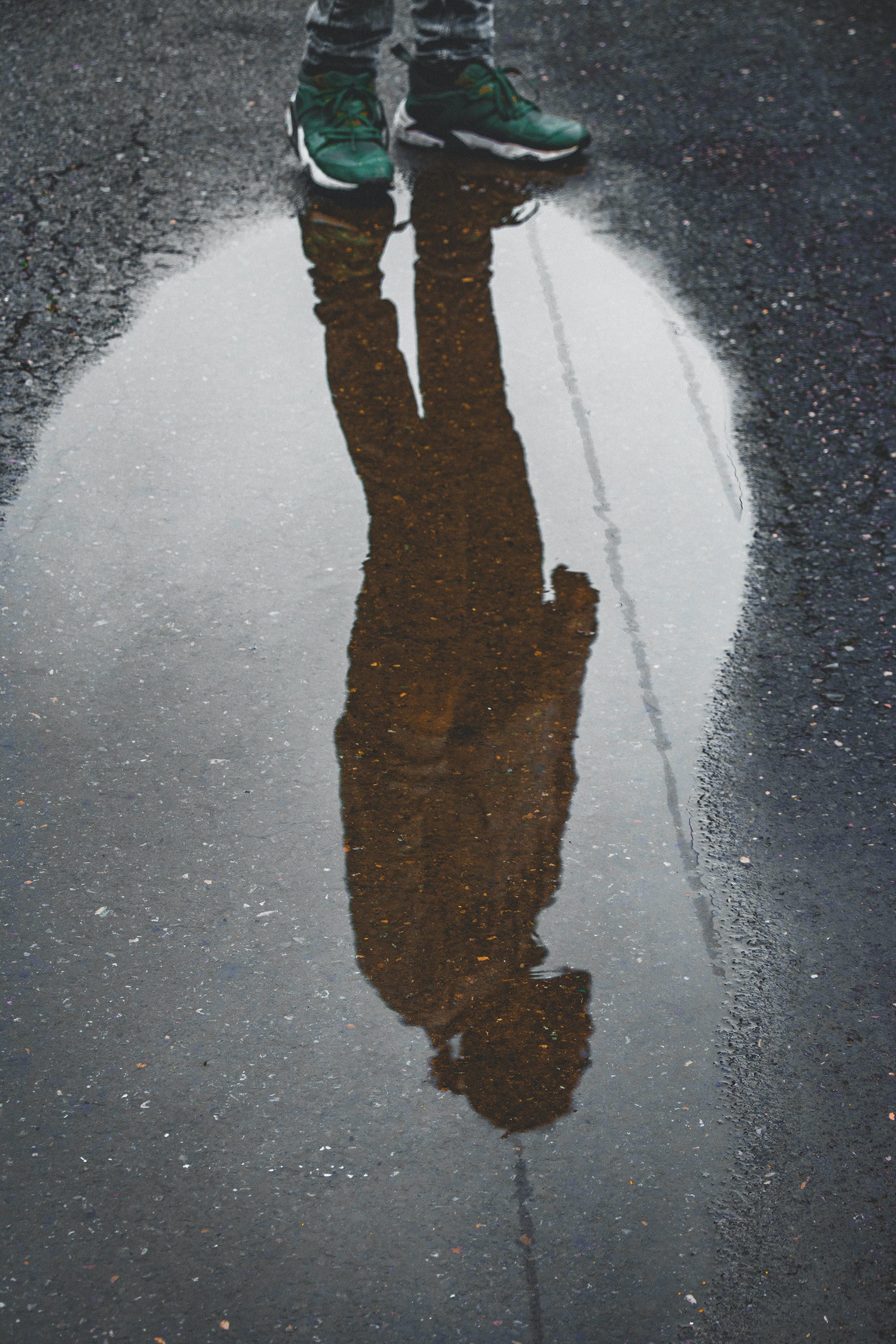 reflection photography of person standing on water