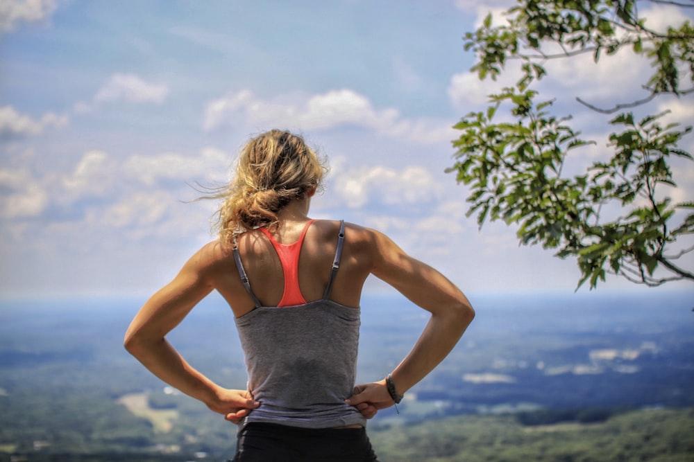 woman standing near tree looking below