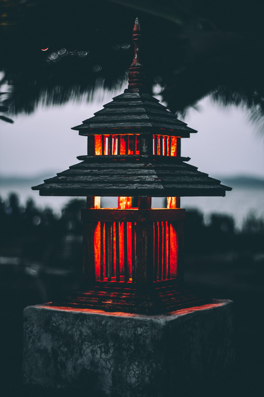 red outdoor lamp on post