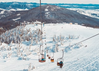 people riding in cable cart on winter season