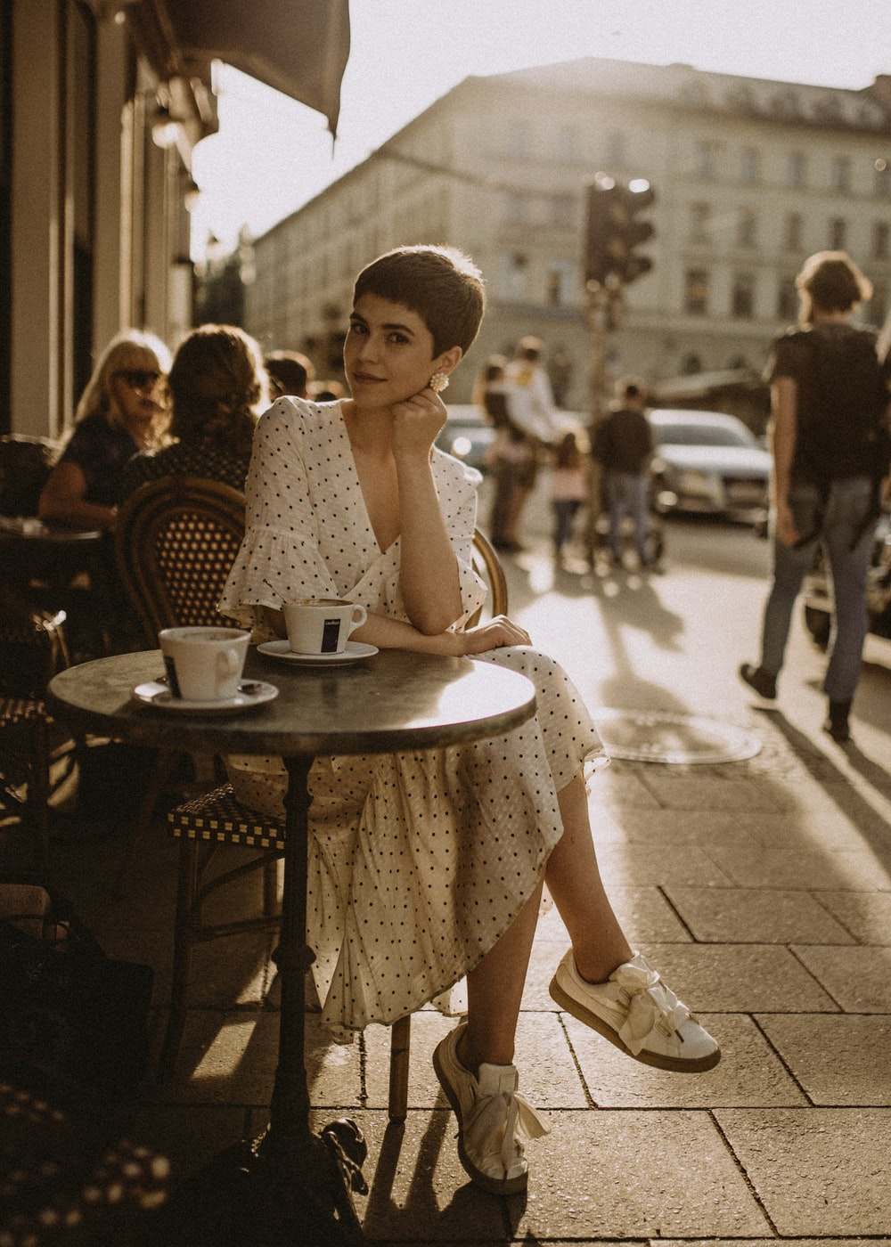 woman leaning on table in cafe