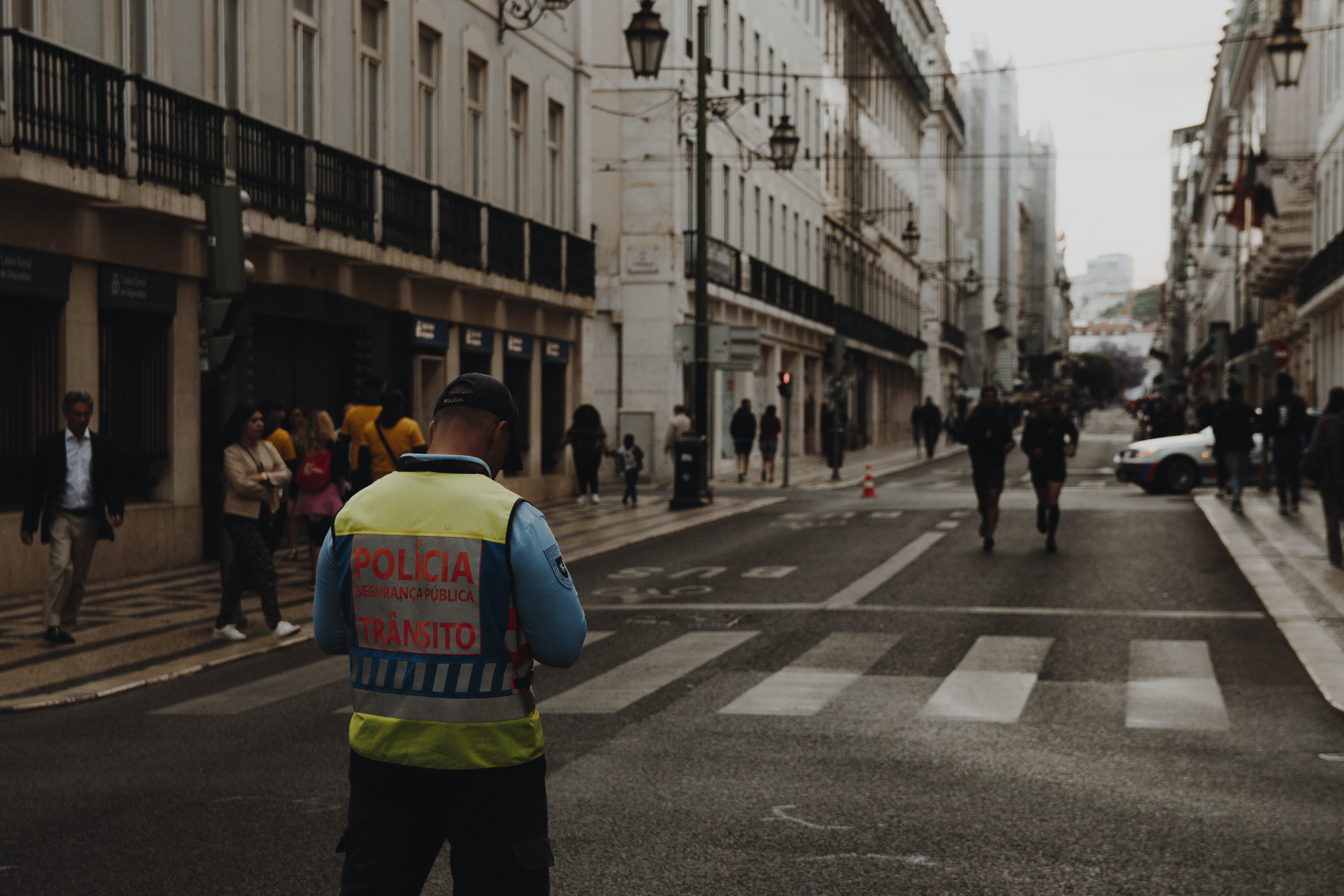 man standing in the middle of street