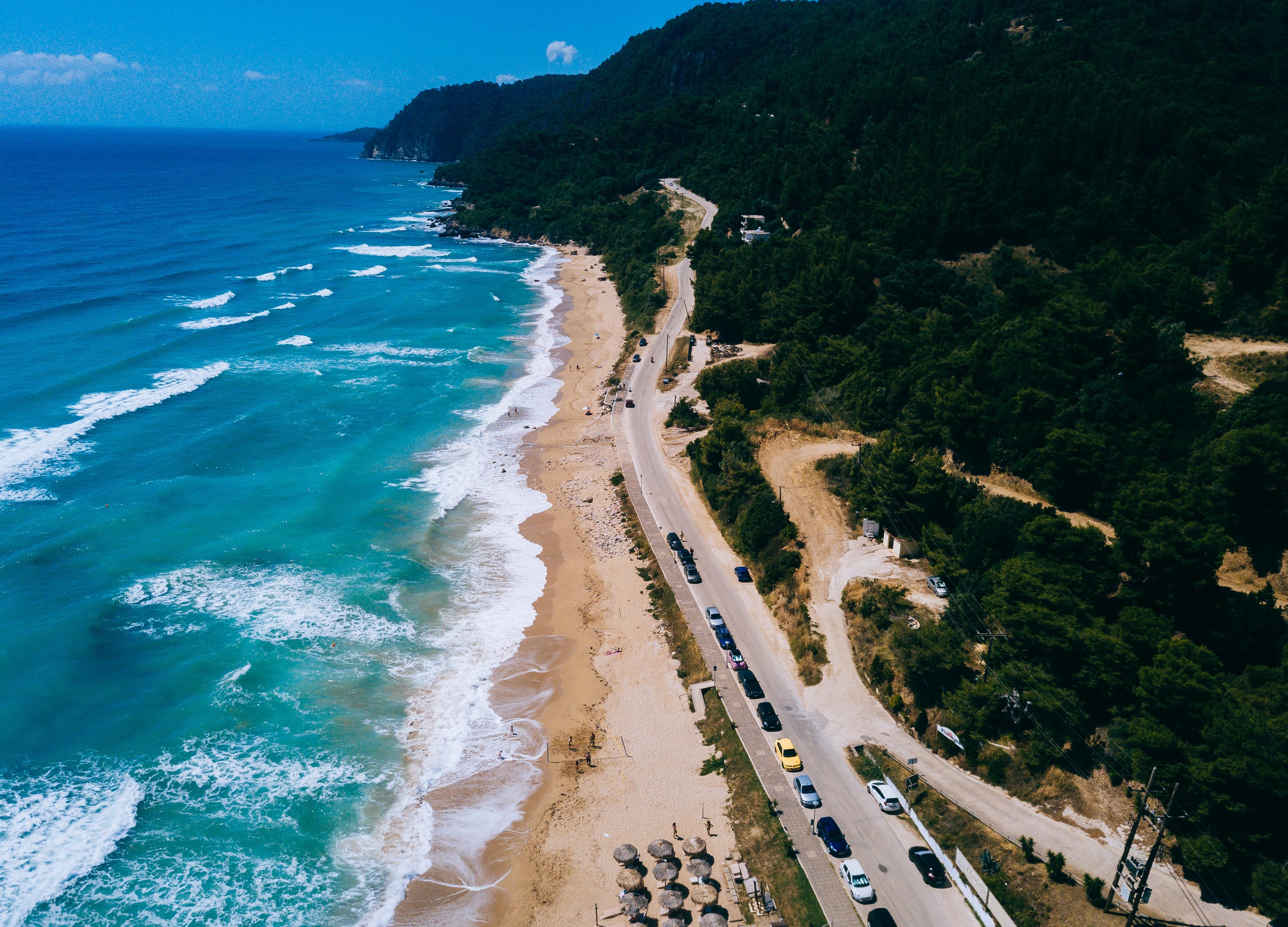 aerial photo of sea near concrete road
