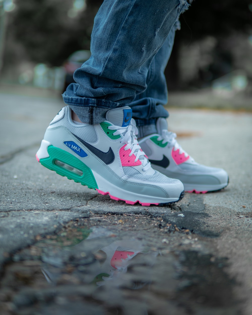 c3aa76a7b4 person wearing blue jeans. person wearing blue jeans. AirMax 90 Summer time