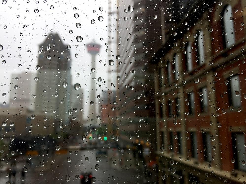 rain drops on clear glass panel