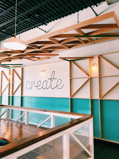 brown wooden wall with create decal