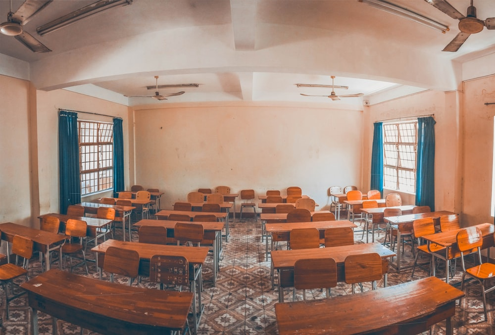 photo of brown wooden school desk