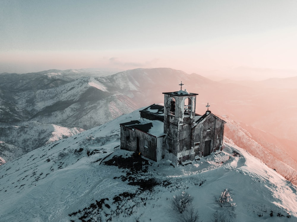 cathedral covered by snow on top of the mountain