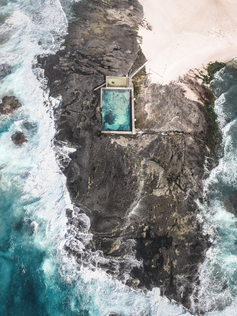 aerial photo of building on rock formation