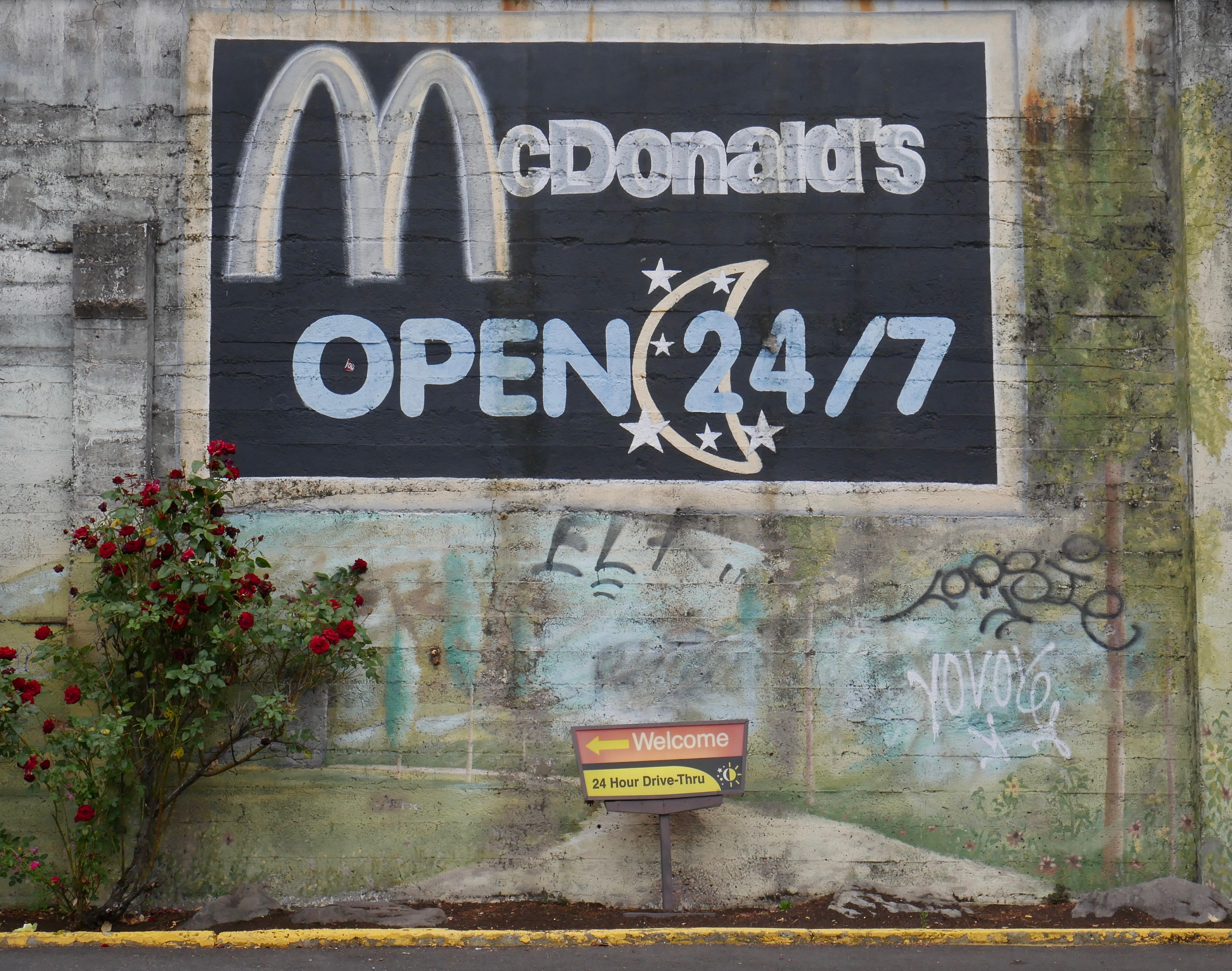McDonald's Open 24/7 graffiti