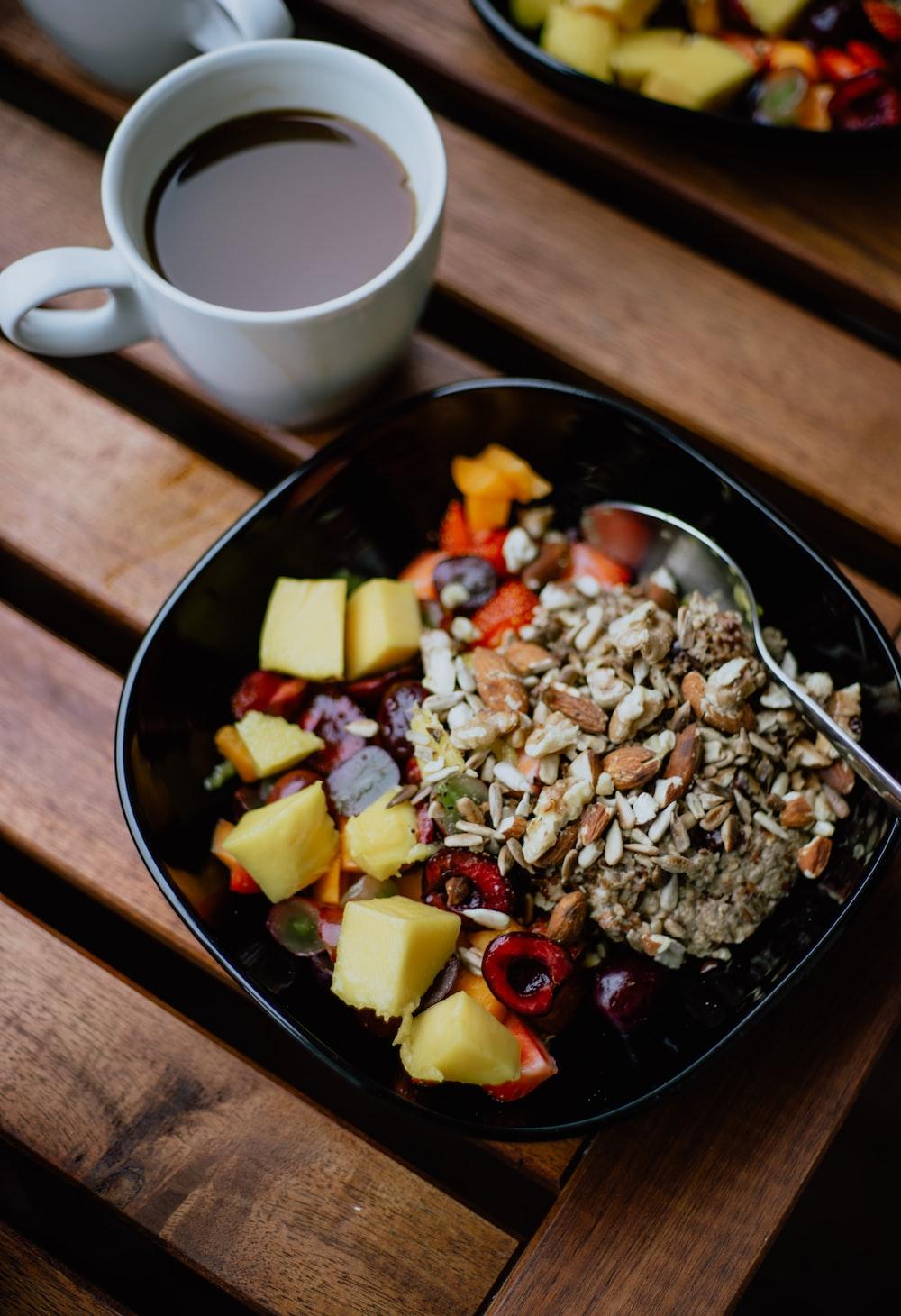 ceramic bowl beside white ceramic mug
