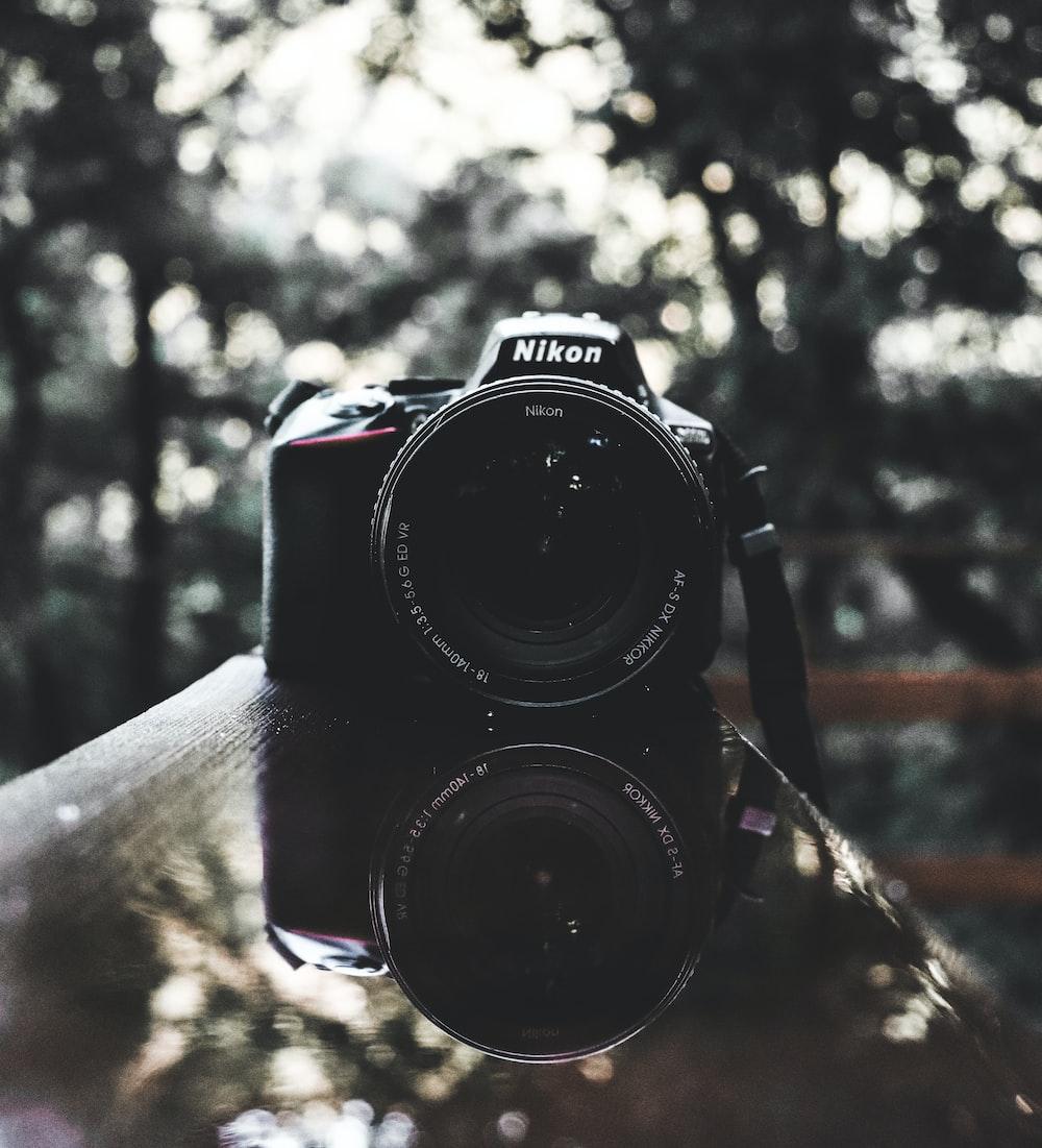 black Nikon DSLR camera turned-off