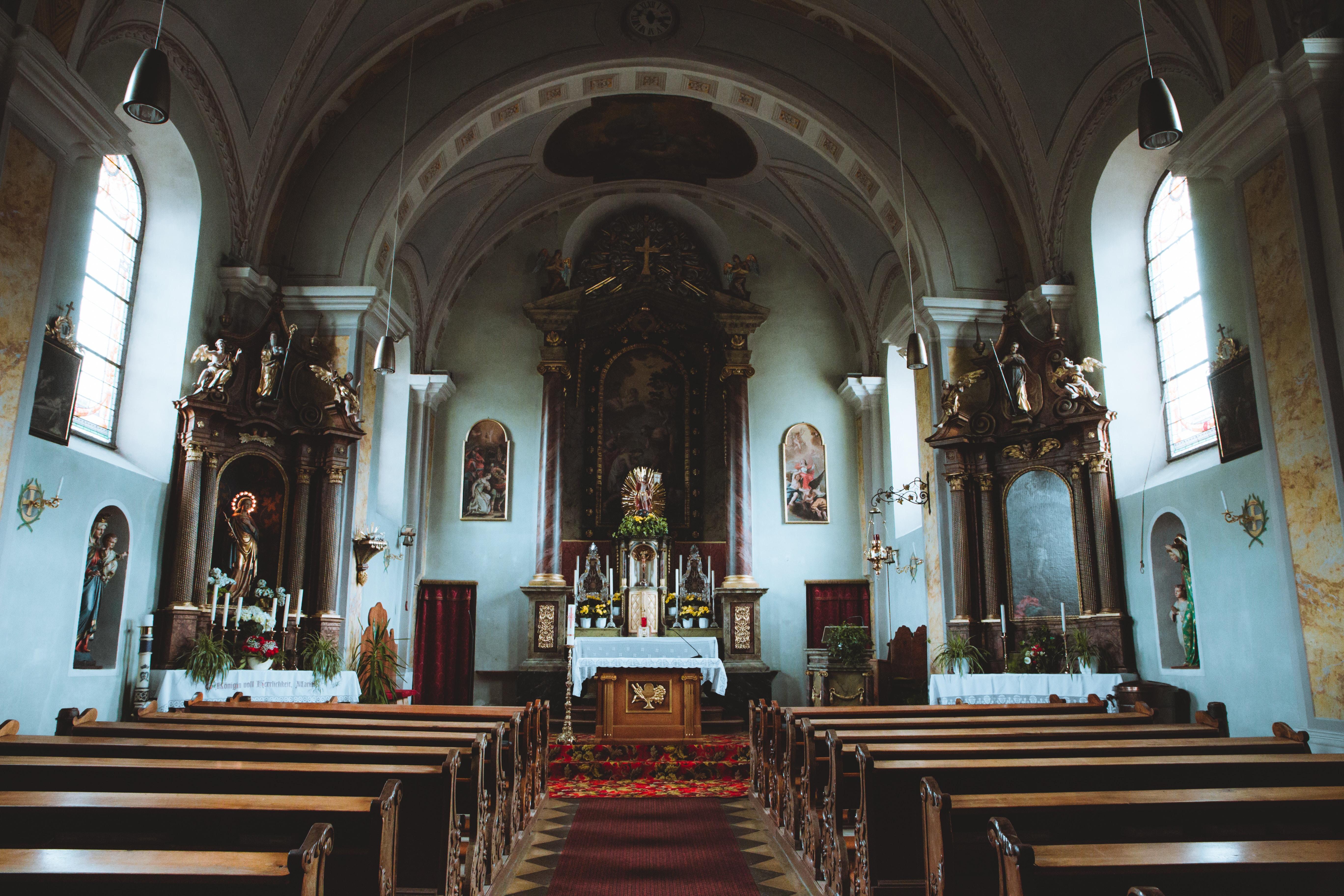 brown church pew inside a blue church