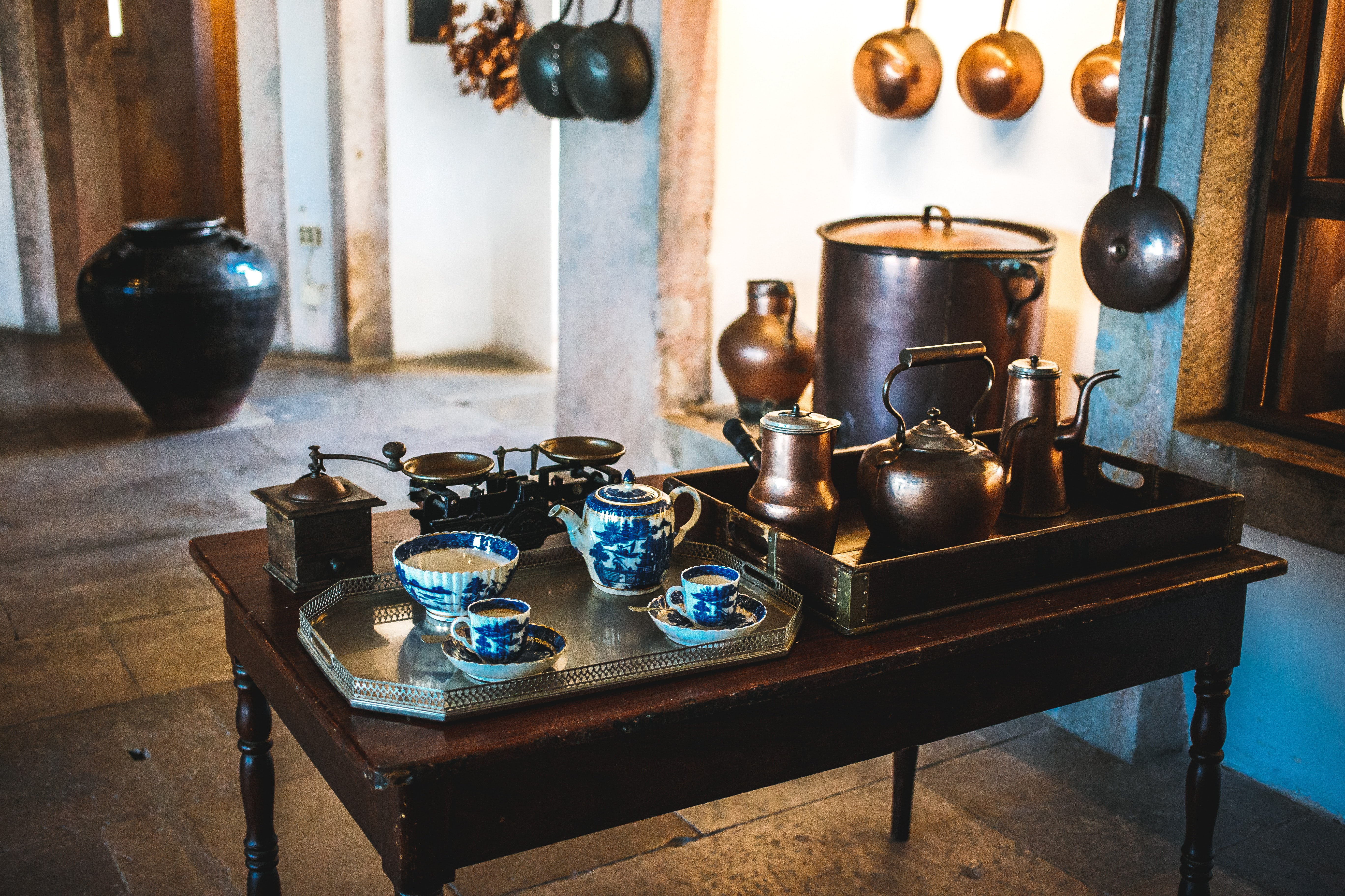 two assorted-color teapot set on top of table