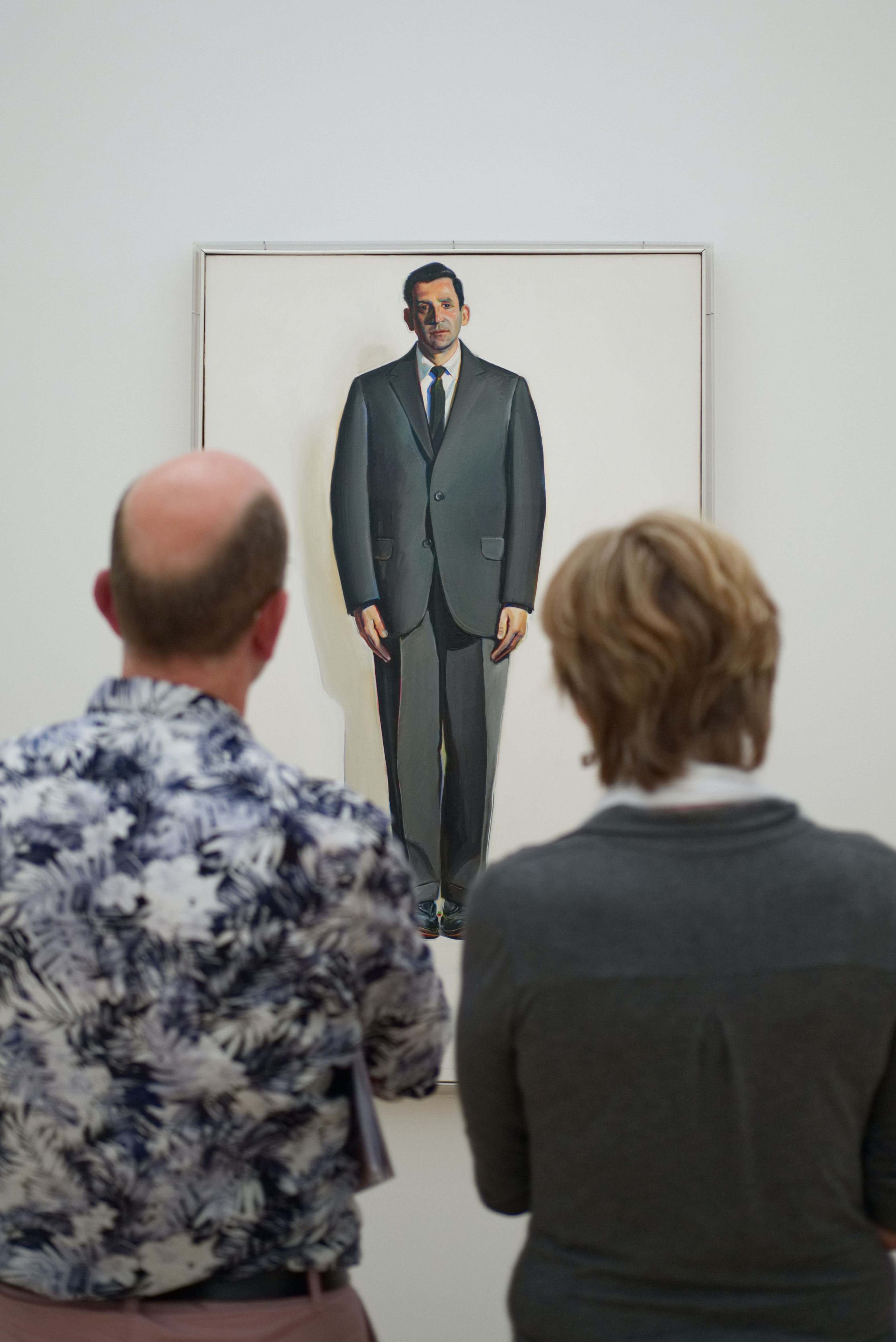 two man standing in front of the painting