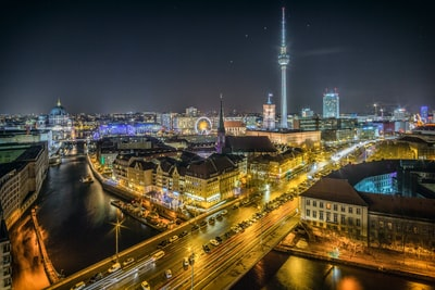 time-lapse photography of vehicle at the road in between the building at nighttime aerial photography germany zoom background