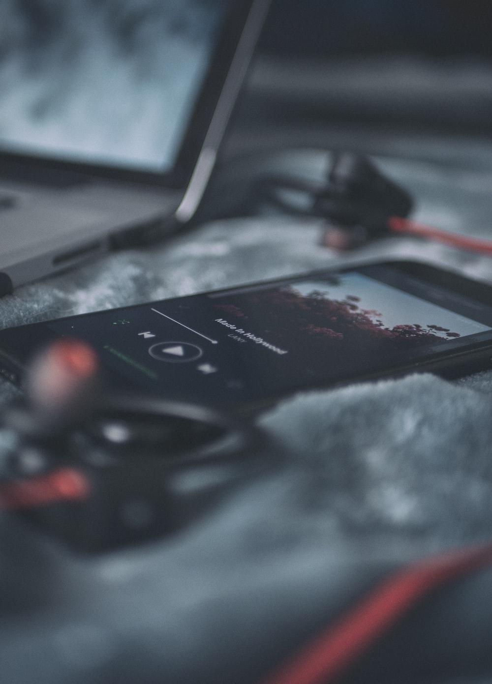 black smartphone on gray textile