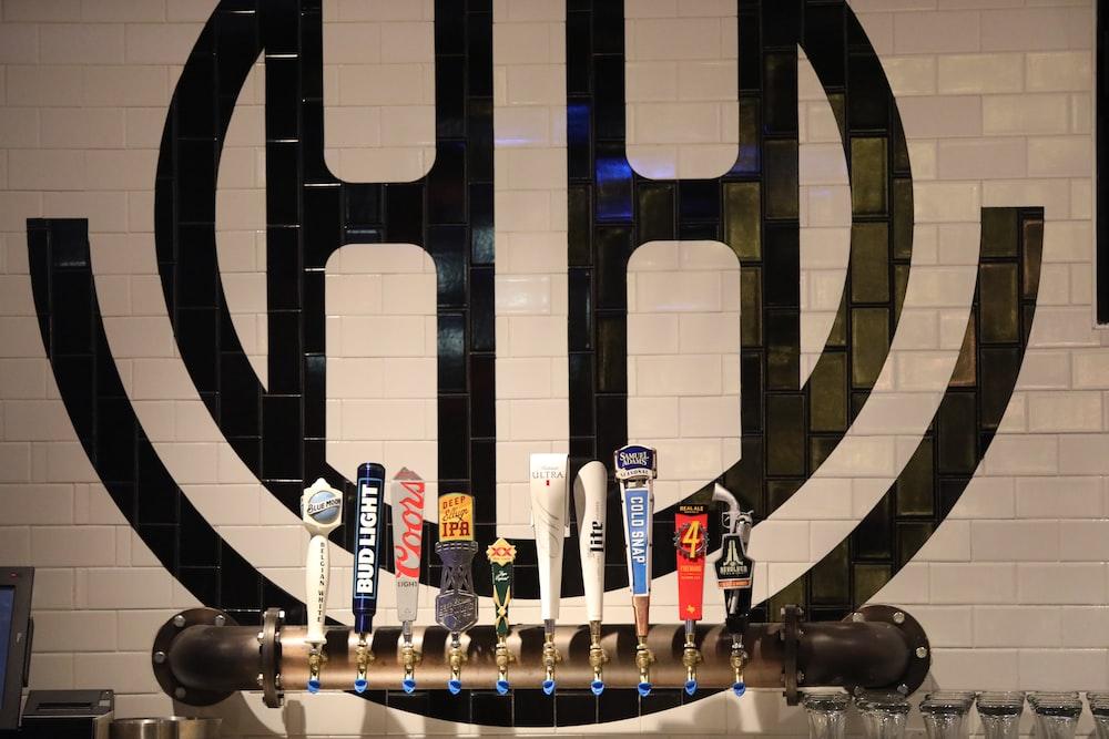 assorted-color beer tap handles