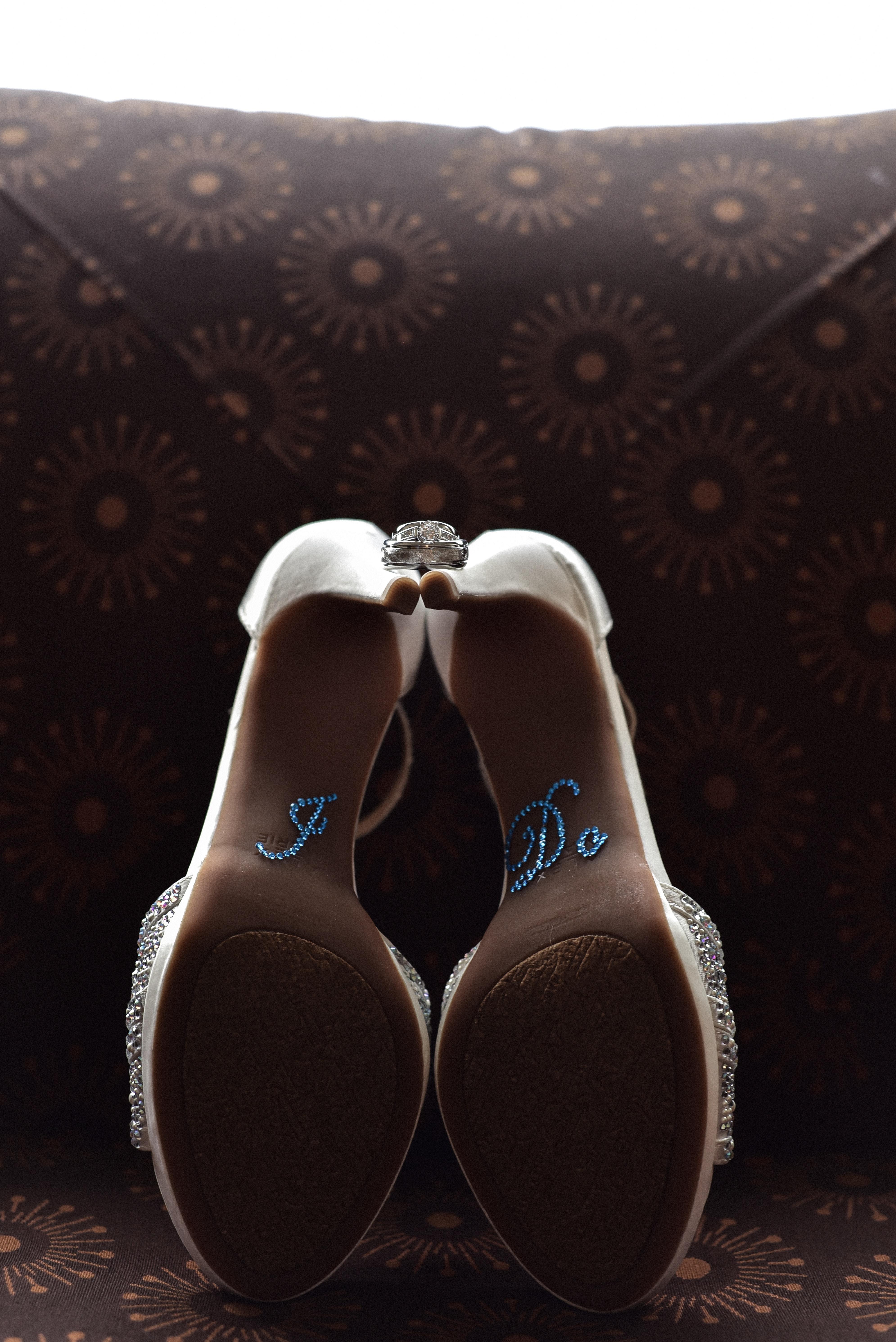 pair of white stiletto shoes
