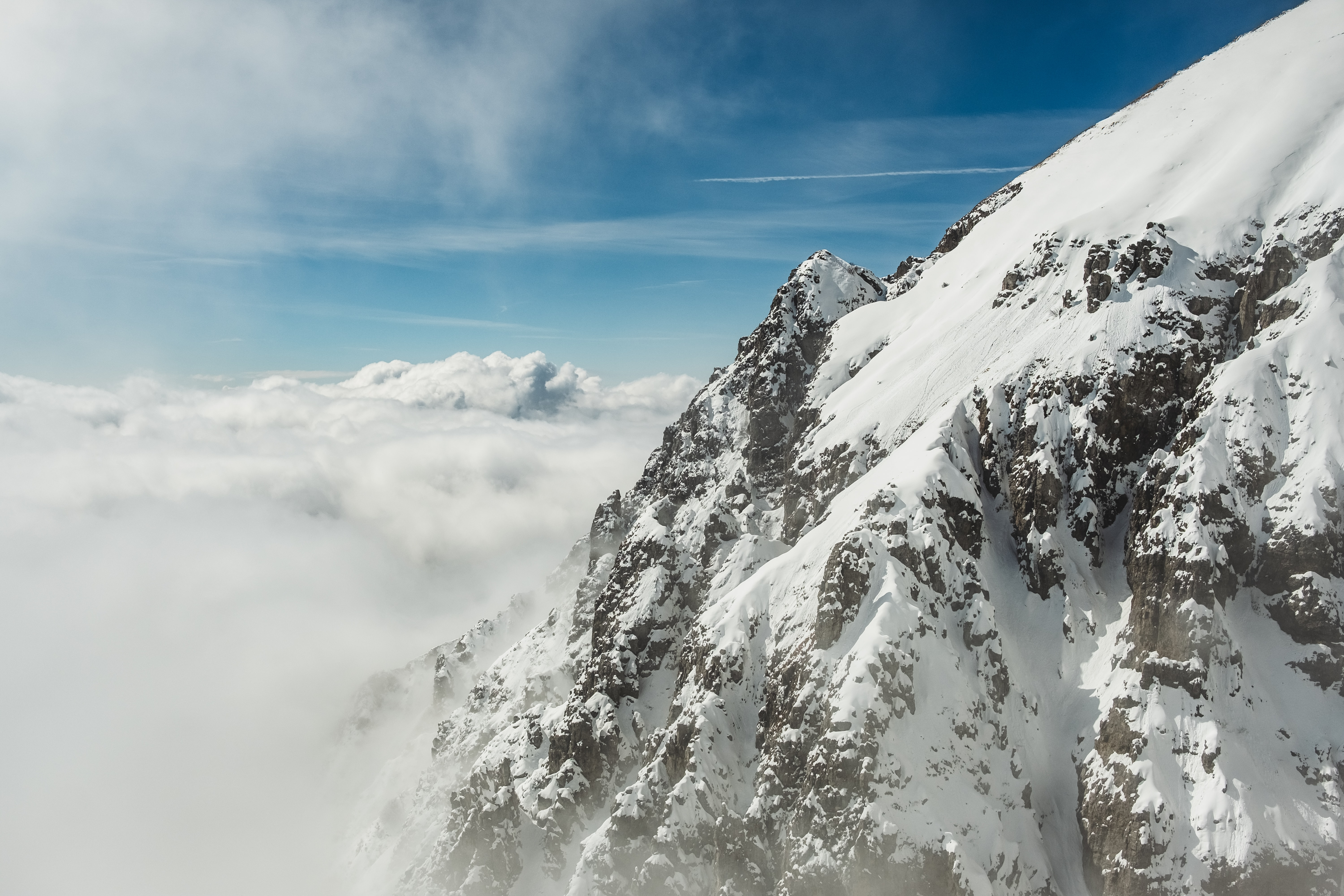 photo of snow covered mountain during daytime