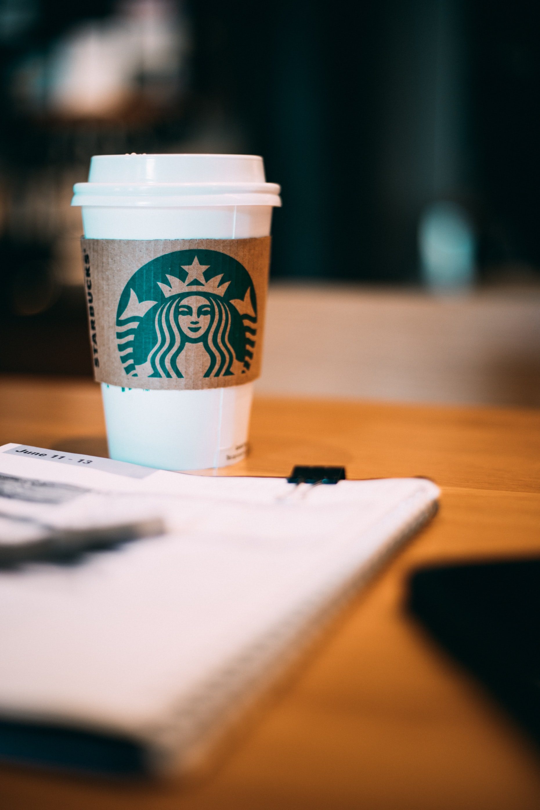 selective focus photography of Starbucks coffee cup