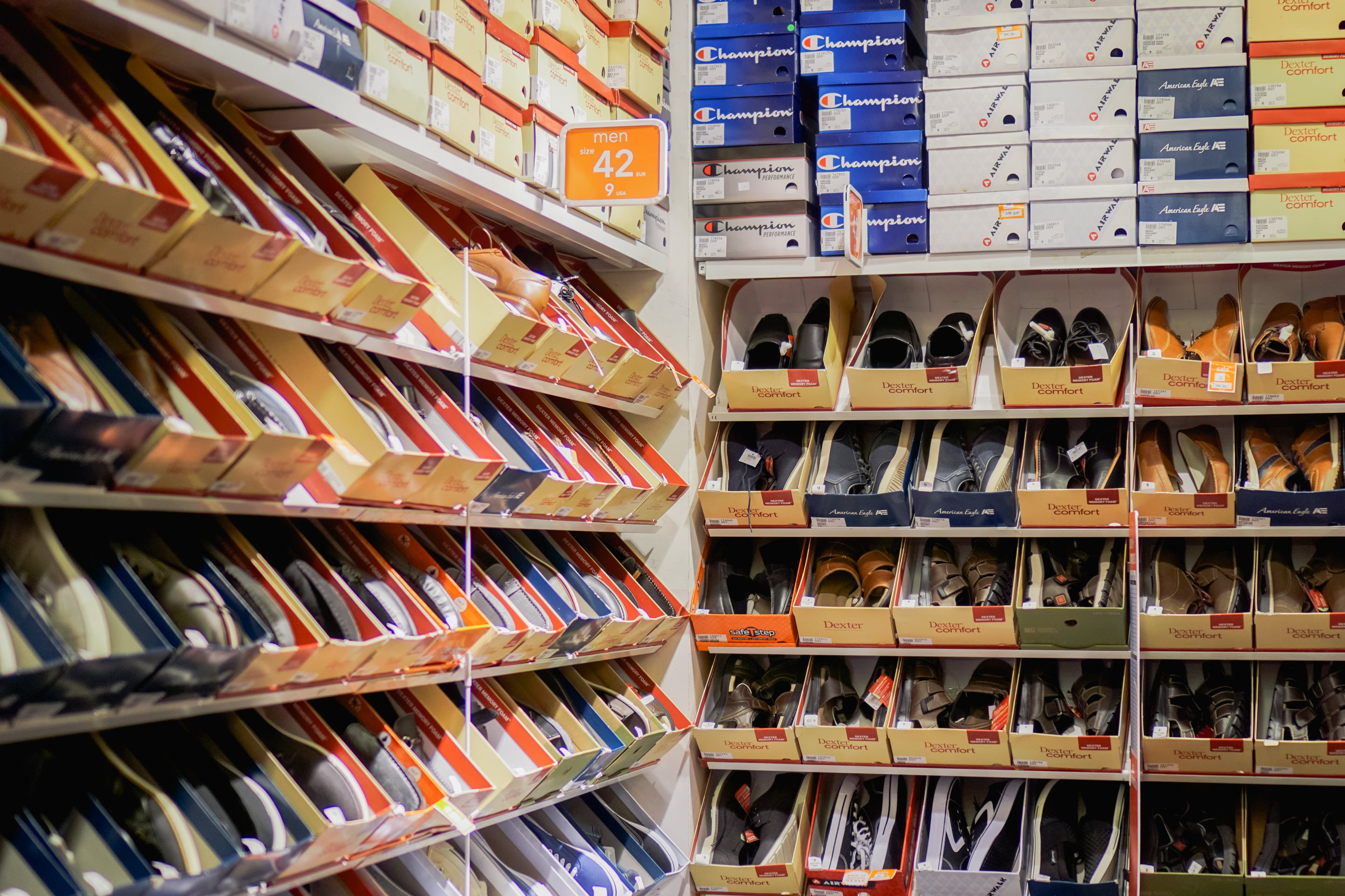 assorted pairs of shoes on boxes