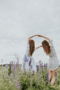 two women holding theier hands