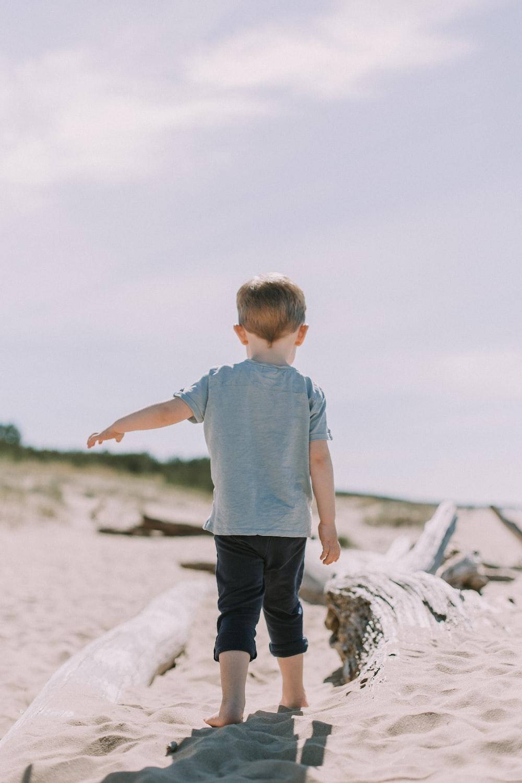 boy standing on sand