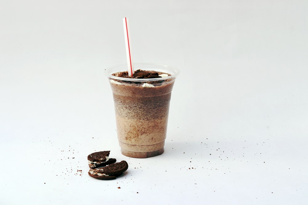 round plastic cup with straw