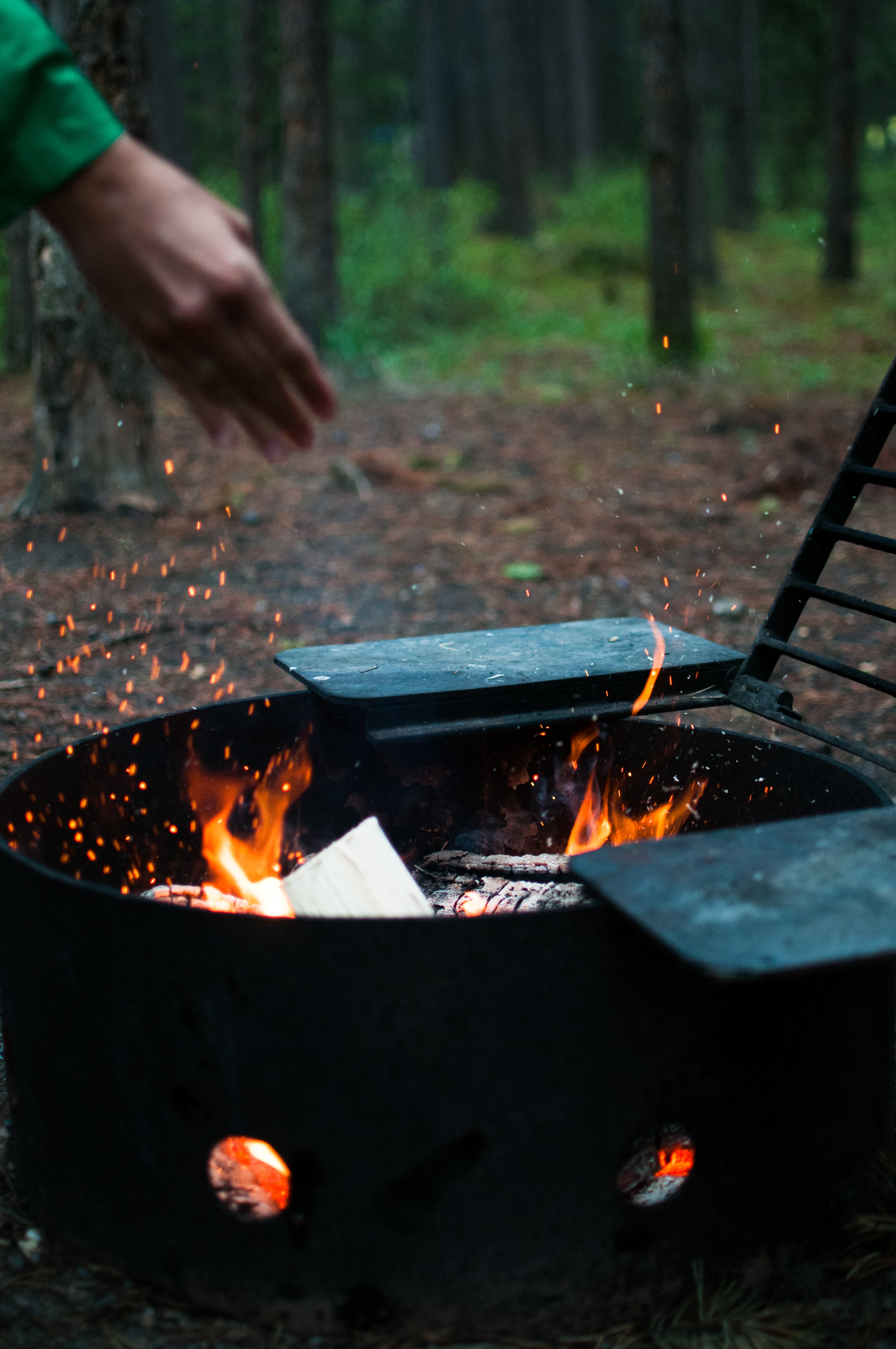 person standing in front of fire pit