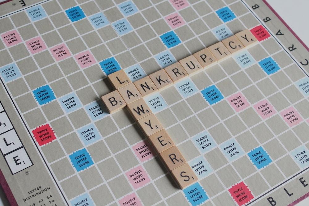 closeup photo of scrabble game board