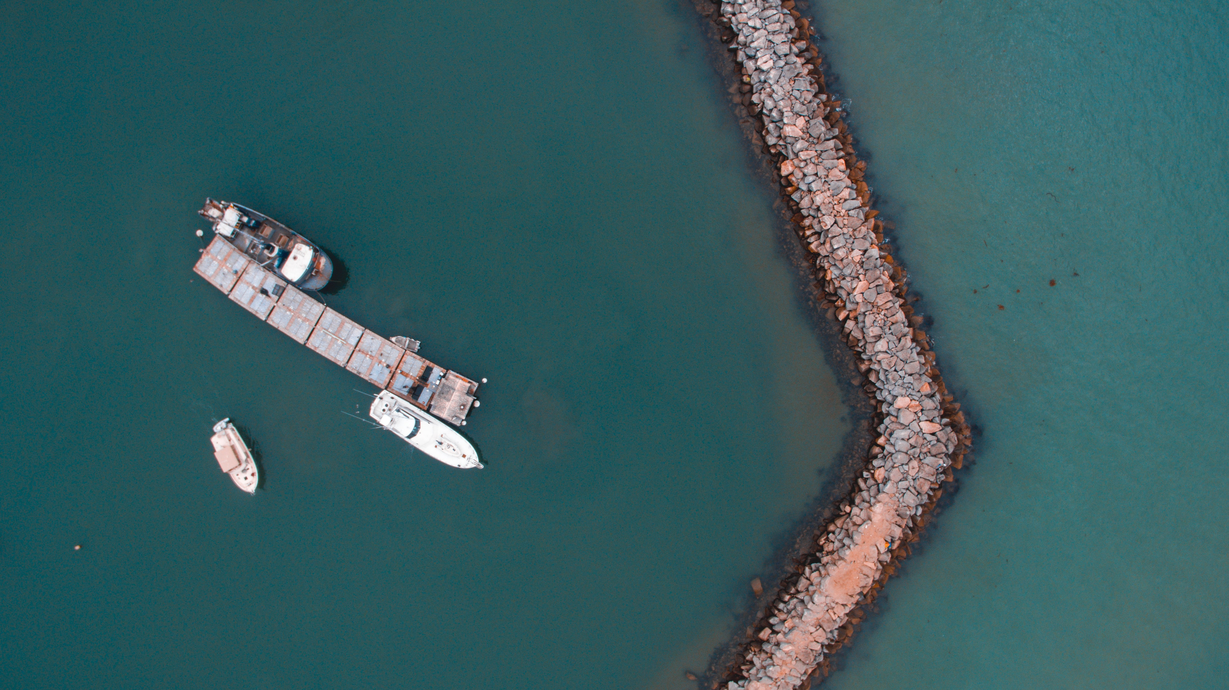 bird's eye view photography of boat near the coast