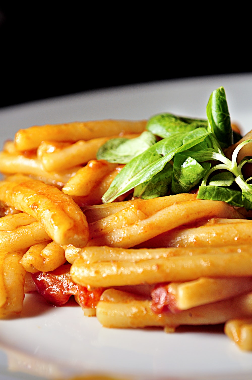 pasta with sauce and leafy greens