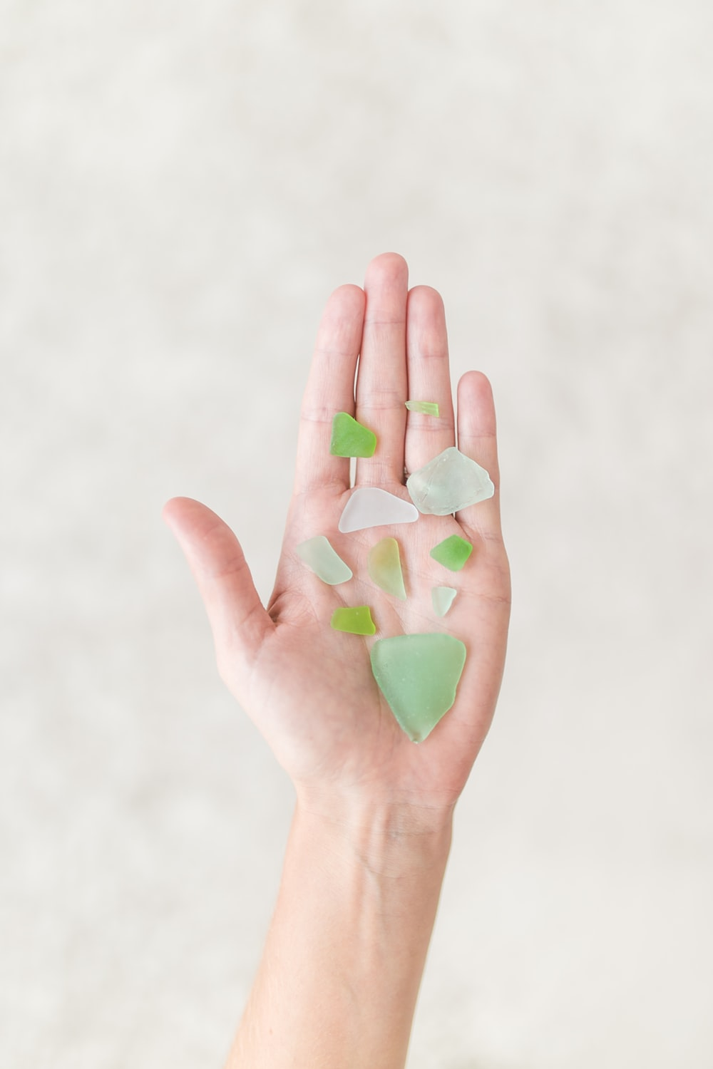 person holding green shards