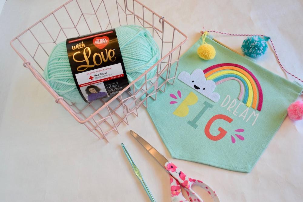 teal yarn in metal basket