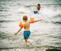 boy going through body of water
