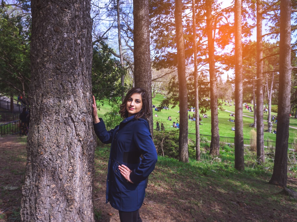 woman standing near tree