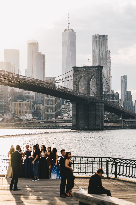 group of people near gray suspension bridge