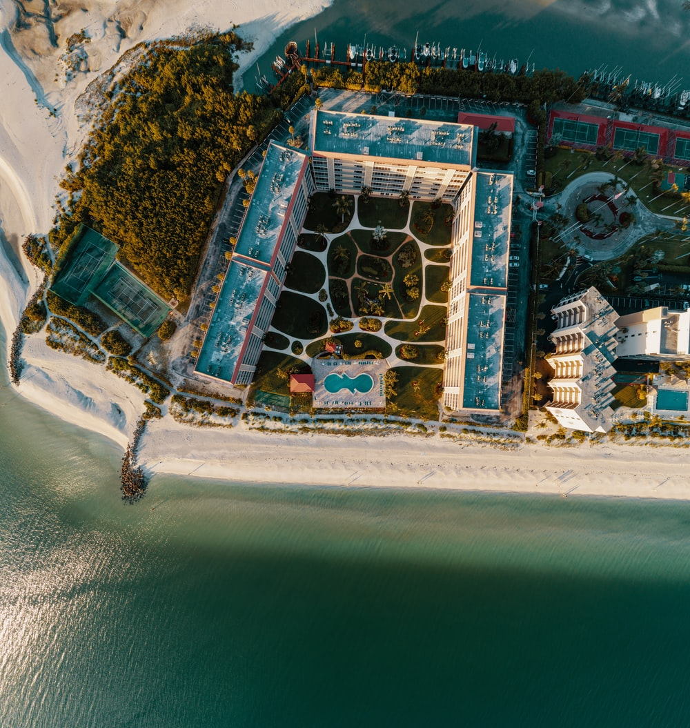 top-view photography of resort near coastline