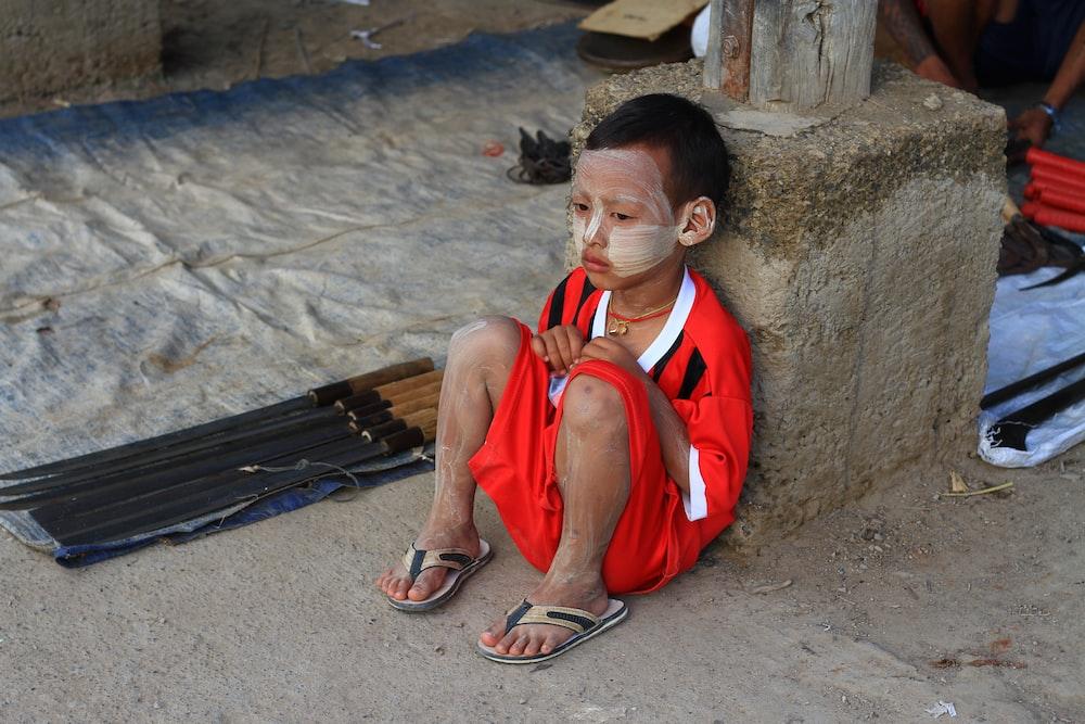 boy sitting on floor