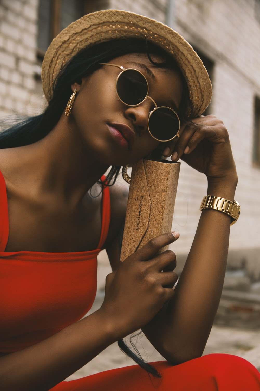 closeup photo of woman holding brown box