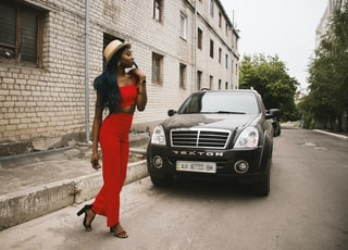 woman standing in front of black vehicle