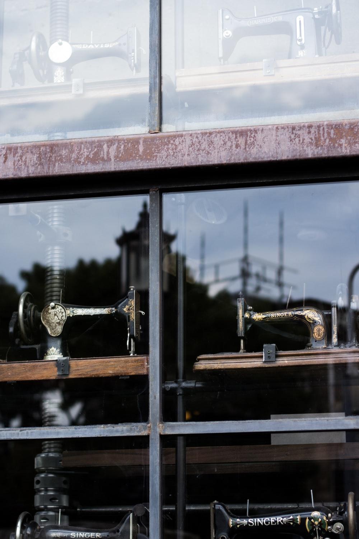 several sewing machine near glass window