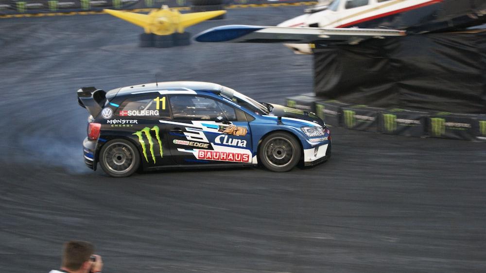 car on racetrack near tarp