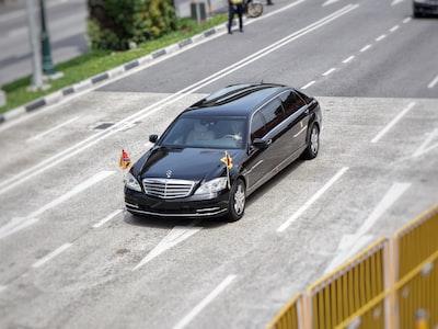 black mercedes-benz vehicle on road president zoom background